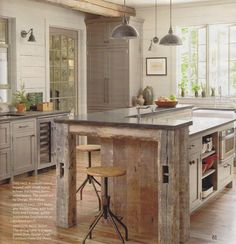 I love how they used barn wood for this island! I hope our forever home will have a spacious kitchen like this!