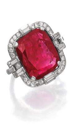 Ruby and diamond ring, circa 1930 Set with a cushion-shaped ruby within a frame of circular-cut and baguette diamonds, size 541/2, French assay and maker's marks.