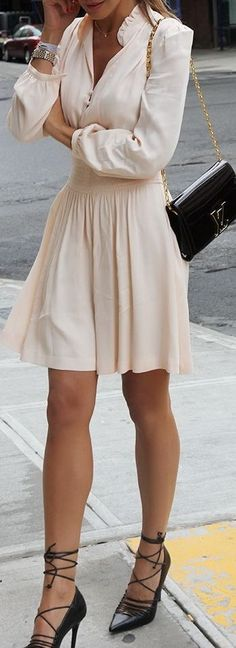 Beige dress with black shoes and bag.