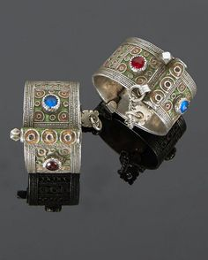 From Morocco ,Western Anti Atlas region a Pair of hinged bracelets of  silver, enamel and glass cabochons.