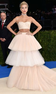 HAILEY BALDWIN wears custom tiered blush two-piece Carolina Herrera with Lorraine Schwartz jewelry and veil.