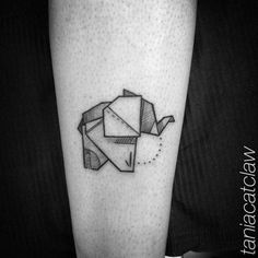 Origami elephan tattoo on the leg. Tattoo artist: Tania Catclaw