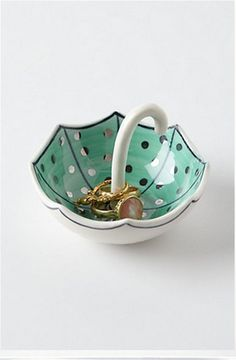Anthropologie umbrella ring dish. Could make  one with polymer or air dry clay.