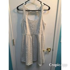 Lauren Conrad knee length dress Lauren Conrad knee length dress. So sweet! White with black polka dots. Has a cutout in the back with a little bow. In like new condition! LC Lauren Conrad Dresses Midi