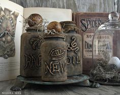 Easy Halloween party decor: No witch's home would be complete without an apothecary of snake oil, newt's eye, toad stool, and raven feet. These DIY bottles were made using plastic vitamin bottles, hot glue, and several coats of black and brown chalk paint.