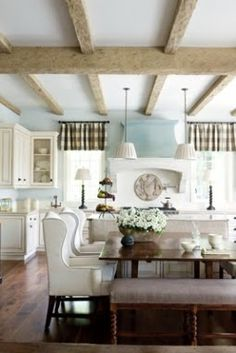 Oh goodness gracious!  What is not to love about this scene!!!  Love the chairs and benches at the table, love the beams - love everything!