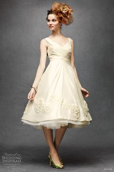 Sassy tea dress with pinwheel appliques, pleated bodice, layers of tulle at under skirt.