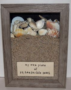 Seaside-themed shadowbox souvenir! How about a custom-sized beach poster for the background, so you're looking off into the sunset?