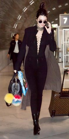 #kendalljenner showing off her catwalk prowess inside the Charles de Gaulle Airport in patent boots April 21,2016, also wearing #Alexandewang bodysuit and #givenchy bag with #Fendi Happy fur. #dailylook from @KendallJennerFan's closet #alexanderwang