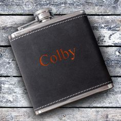 Make a statement on the next wedding party you attend with the elegant Personalized 6oz Suede Flask perfect for groomsmen gifts. This personalized flask separates you from the rest with its elegant suede design and orange lettering. The personalized design approach offers you the opportunity to communicate your personality and uniqueness to the world