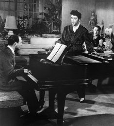 """'You're so Young and Beautiful' - closing scene from """"Jailhouse Rock"""" - Mike Stoller half of the Leiber-Stoller songwriting team is at the piano. Scotty Moore in the background. John Lennon Beatles, The Beatles, Elvis Presley, Prison, Scotty Moore, Rock Background, Lisa, Jailhouse Rock, Buddy Holly"""