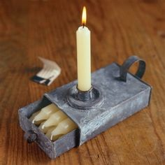 Galvanized taper tin with candles.  You can never have too many candles.