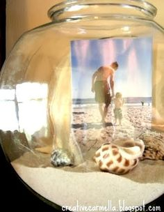 Photo display ideas for beach memory keeping in jars and vases from Completely Coastal