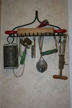 Old kitchen utensils displayed on old rake head.