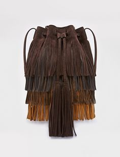 Bucket bag in suede with fringes. Adjustable shoulder strap. Drawstring fastening with tassels. Protective studs. Inside open and zipper pocket. Logo on the lining. Measuring 24x22x12 cm. - Free Shipping and Returns