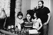 """Susan Polgár, premiere chess master of a family of chess master players. Polgár was born on July 23, 1976, in Budapest. Polgár and her two older sisters, Grandmaster Susan and International Master Sofia, were educated at home by László and his wife, Klára,  to prove that children could be exceptional if trained in a specialist subject from a very early age.  """"Geniuses are made, not born"""", was László's thesis."""