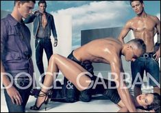 This Dolce and Gabbana ad looks like the men are gang raping the woman. Look how they are hovering around her, and how the man above her is pinning her to the ground.  Link: http://thesocietypages.org/socimages/files/2011/01/213.jpg