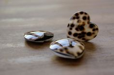 3 Beautiful cowrie shell heart shape beads, 30x30mm Please be aware due the beads are handmade the size could vary slightly.  The cowrie shell