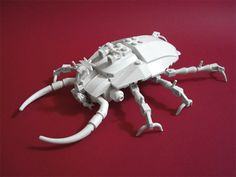 LEGO insect. White Beetle by Lino Martins, 2010. It's not a digital rendering—it's made from 200 Lego pieces.