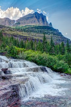 Pyramid Creek Falls located above Mokowanis Lake. Glacier National Park, Montana; photo by .John and Jean Strother