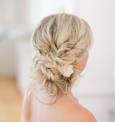I'm digging the soft, loose look with the unfussy braid.   Gorgeous Wedding Hairstyles That Will Leave Any Bride Tressed To Impress - MODwedding