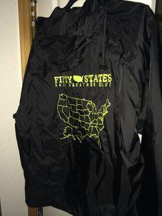 Black wind and rain jacket - awesome for a rainy run - Packaway jacket - Fifty States Half Marathon club running gear www.50stateshalfmarathonclub.com