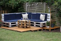 Low Budget Pallet Outdoor Lounge (for the time being, I just wish I had enough garden for something like this to fit)