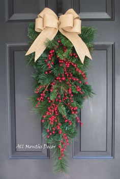 Red Berry Christmas Teardrop Wreath. Perfect for winter and Christmas home and door decor, and gifts. - Decorative red berries - Natural burlap bow - Created on a artificial pine wreath teardrop swag