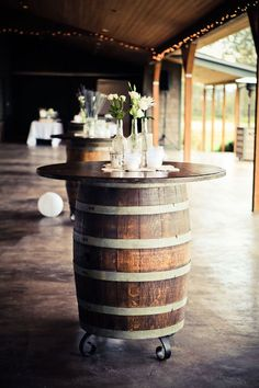 With their rustic charm and versatility, whiskey (and wine) barrels are an easy way to really bring your wedding decor from drab to fab. From flowers stands, to cocktail tables we've found some great whiskey barrel styling ideas for your big day! Barn Wedding Decorations, Table Decorations, Diy Wedding Tables, Diy Wedding Bar, Party Wedding, Chic Wedding, Luxury Wedding, Summer Wedding, Wedding Favors