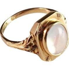 18k Gold and Moon Stone Ring. Johan Pettersson, Stockholm 1920. In between Art…