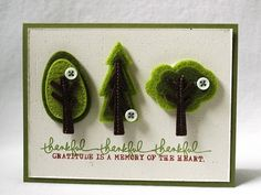 Felt trees.  Love the layers and clean look!