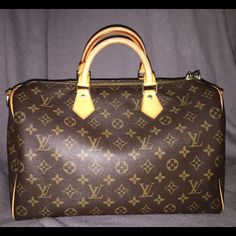 LOUIS VUITTON SPEEDY BANDOULIERE 35 Monogram canvas and natural cowhide leather Two rolled leather handles Double zip closure One pocket Detachable/adjustable shoulder strap Made in France Date code: VI1124 Accessories: N/A. No strap no box or no dust bag.   Condition: Slightly used.   Measurements: 13.8 x 9.1 x 7.1 Louis Vuitton Bags Satchels