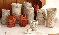 love these coil pots! Try making coil pots like these at ceramics this week.