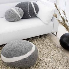 felted 'stone' pillows and pouf in light grey with white veining