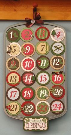Advent calendar made from a muffin tin and paper, attached with magnets....tuck a little treat behind each number.