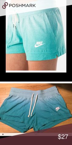 New with Tags Nike Vintage Gym Shorts Sz M NWT Women's Nike Vintage Shorts in Ice Blue Size M. Shorts have a ombré color effect with drawstring. Nike Shorts