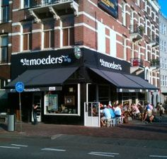 Moeders (= Dutch for mothers) opened in 1990. The owner, Jurriaan, asked all his guests to bring a plate, glass and cutlery to the opening. With all those different plates, wineglasses and cutlery the wooden tables in the restaurant are still set today. At the same time Moeders started collecting pictures of mothers.