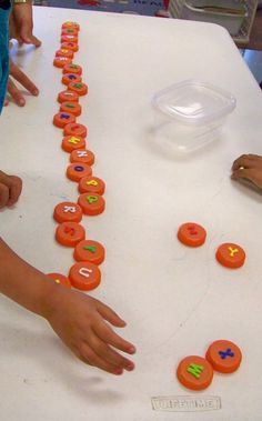 Growing in Pre K - ABC Center.  I really like this idea and am going to save bottle caps to make some of these.  Love the tactile aspect.  Would make upper and lower case. Also, the student who eats paper would not put these in her mouth --- I think.