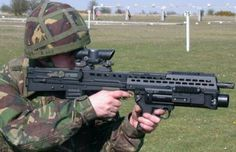 British soldier sights the L85A2 rifle fitted with German-made 40mm grenade launcher
