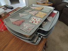 "Moda Bake Shop:Organized Piecing: ""Carol came up with the clever idea of using baking sheets from the dollar store to organize her quilt pieces.  She arranges them on the cookie sheet (four blocks per sheet for this particular project) and then she has a nice tidy stack next to her sewing machine. It makes it quick and simple to jump back into a project when you get distracted. """