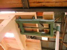 Bench Vise by Greedo -- Homemade bench vise constructed from square tubing, flat bar, threaded rod, pipe, nuts, and lumber. http://www.homemadetools.net/homemade-bench-vise-3
