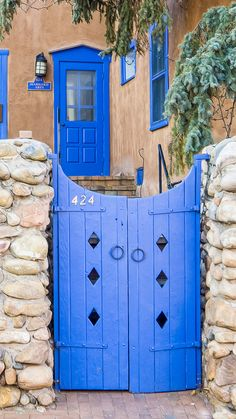 Image taken while driving on Canyon Road in Santa Fe NM. Lots of blue and purple doors out there. Skinny composition due to some less than scenic elements outside the frame. Old Doors, Windows And Doors, Fachada Colonial, New Mexico Style, Santa Fe Nm, Purple Door, Santa Fe Style, Adobe House, Canyon Road