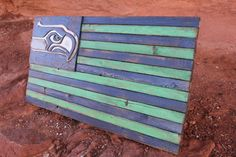 Seattle Seahawks Wooden Flag by LoyalWood on Etsy Each Flag will come ready to hang with a bracket on the back side.   ~ The dimensions of this flag are 36L X 20W X 2T $150