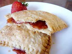 Homemade Pop-Tarts with two filling variations:  Cinnamon Sugar and Strawberry