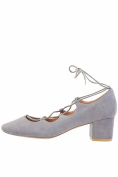 0ff9acbb7f57 These beautiful midi pumps feature a chunky heel and corset style lace to  give you the. Shoptiques