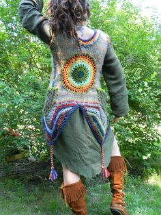 Rainbow Inspired crocheted MANDALA up-cycled wool sweater VEST w/ side pockets and 3 Driftwood buttons - multi colored rainbow with tassles. $100.00, via Etsy.