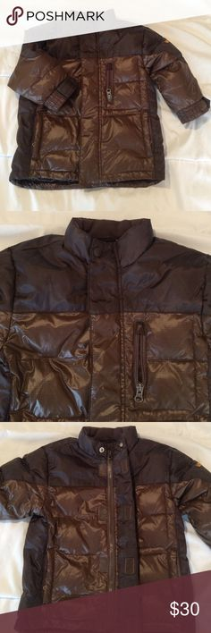 Kids winter coat Gap kids winter coat. This coat is in great used condition. No stains or marks. It's filled with down feathers so you'll see the Feathers peak out occasionally. It's two toned brown and has 3 pockets on the front of the coat. Velcro flap covers the zipper. I loved this coat!😎 GAP Jackets & Coats Puffers