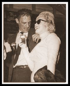 Marilyn Monroe & Arthur Miller in Jamaica, 1957. She's carrying a fur; he's sweating.