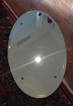 Vintage large oval frameless mirror $165