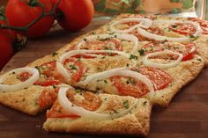 Tomato Flatbread is popular on restaurant menus, and now you can make it at home...easily. The key is to start with really good tomatoes. And we recommend topping it with fresh slivered basil, too.